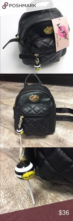 Betsey Johnson backpack purse lollipop nwt Betsey Johnson backpack purse lollipop nwt 7x8x4.5 such a cute backpack purse . Has an adorable lollipop zipper pull Betsey Johnson Other
