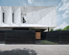 "Openbox Architects tops Bangkok house with ""monolithic piece of marble sculpture"""