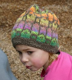 Multi-colored hat that looks fun to knit.  In grown-up sizes too!
