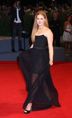 All the Best Looks From the 2016 Venice Film Festival | Amy Adams in a sleek corseted strapless gown with a sheer chiffon overlay and platform Jimmy Choos.