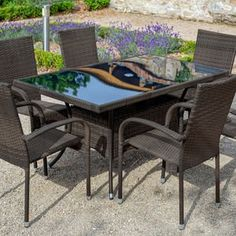 Get your garden ready for summer with stylish Santona rattan furniture set. Includes a large table and 6 chairs, perfect for alfresco family dining. Home Store +