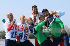 Silver medalists Liam Heath and Jon Schofield of Great Britain, gold medalists Saul Craviotto and Cristian Toro of Spain and bronze medalist Aurimas Lankas and Edvinas Ramanauskas of Lithuania take a photo on the podium during the medal ceremony for the Men's Kayak Double 200m event at the Lagoa Stadium on Day 13 of the 2016 Rio Olympic Games on August 18, 2016 in Rio de Janeiro, Brazil.