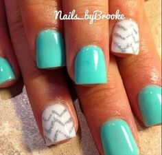 Turquoise acrylic nails with white and silver chevron design