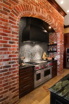 Not a huge fan of the dark brick, but I love the idea of having a niche for the stove area. I like the hidden shelving on each side.