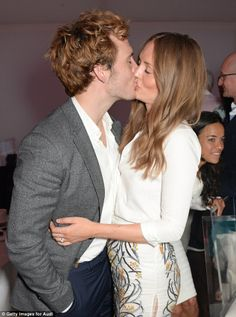 Loved up: Sam Claflin shared a passionate kiss with his wife Laura Haddock while at the Au...