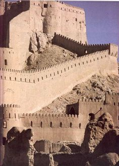 "The Arg-é Bam (ارگ بم in Persian, ""Bam citadel"") was the  largest adobe building in the world, located in Bam, a city in the  Kerman province of southeastern Iran"