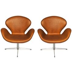 Arne Jacobsen Swan chairs for Fritz Hansen (2 Chairs) | From a unique collection of antique and modern lounge chairs at http://www.1stdibs.com/furniture/seating/lounge-chairs/