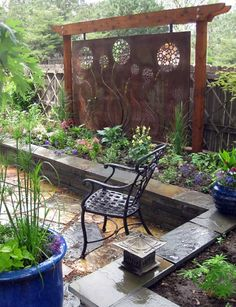 A Beautiful Custom Metal Art Plate Is Used As A Focal Point For This Back  Patio
