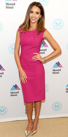 Jessica Alba turned heads in a figure-flattering fuchsia Roland Mouret sheath, expertly accessorizing with a black carryall and metallic silver pumps.