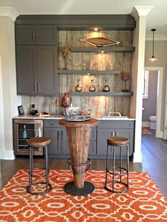 cabinet color and wood like backsplash with white uppers~
