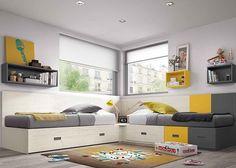 Dormitorio infantil con dos camas modulares con cajones.