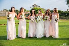 San Diego wedding at lomas santa fe country club bride strapless tulle ball gown with beaded bodice and purple sash with bridesmaids long blush pink strapless dresses with white floral bridal bouquets