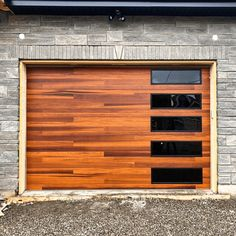 You shouldn't have to choose between curb appeal and practicality. Even up close, our Planks garage doors look as rich, authentic, and vibrant as natural wood. A dual layer of UV protection maximizes color retention, even in the harshest environments. Swipe to see what the inside of this garage looks like! Order your FREE Accents Woodtones color samples today. Shown: Planks from the Contemporary Collection in Cedar with optional black window frames. // via @garagedoordepot on IG Faux Wood Garage Door, Garage Door Windows, Modern Garage Doors, Windows And Doors, Black Window Frames, Black Windows, Indian Springs, Types Of Insulation, House Elevation