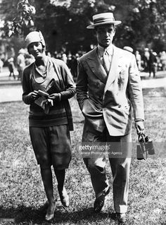 John Hay Whitney (1904 - 1982) son of the late Payne Whitney, the American millionaire and sportsman with Elizabeth Altemus from Philadelphia, a prominent socialite. Jock inherited the famous Payne Whitney stable on his fathers death and Miss Altemus was his house guest at the opening of the current race meeting.