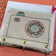 A different kind of pencil pouch... Smile for the camera, Beautiful! Embroidery pattern by @alisonglass with a twist by me #alisonglass #embroidery #pencilpouch | by sew alex