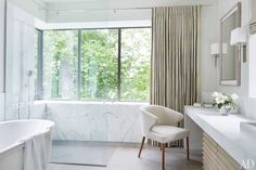 The master bath of a Tennessee house, which was renovated by the architecture firm DA|AD and decorated by McAlpine Booth & Ferrier Interiors.