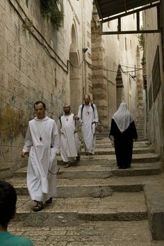 Christian Monks and a Muslim Woman in the Old City of Jerusalem