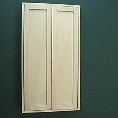 Checking the fit of shaker style doors in a dolls house scale armoire. - Photo copyright 2010 Lesley Shepherd, Licensed to About.com Inc.