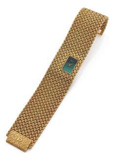 PIAGET <br /> Jean Été Paris, ref. 3879 D1, n° 191946, vers 1970 <br /> Montre bracelet de dame en or jaune 18K (750). Boîtier rectangulaire intégré dans le bracelet