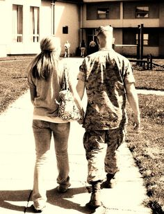 You're not suppose to hold hands in uniform but when you're never sure of how short of time you have together until he's deployed you take any chance you can for love.