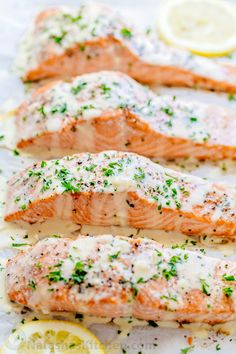 Oven Baked Salmon with flavorful and simple lemon cream sauce. Lemon beurre blanc, will be your secret weapon for seafood recipes. Gourmet flavors at home! | natashaskitchen.com