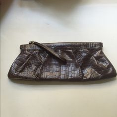 Brown leather clutch Great brown clutch with a pull zipper. Inside has a zippered pocket and a card holder. Worn at the edges as shown in pictures. Alfani Bags Clutches & Wristlets