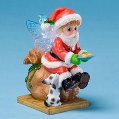 My Little Kitchen Fairies-Santa Dressed Fairie Figurine is a fun accent for your home.