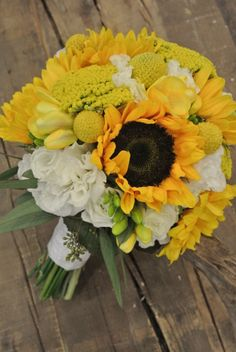 Yellow Bridal Bouquet with sunflowers, Yallow, Craspedia, Lisianthus, Freesia and Seeded eucalyptus.