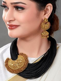 Featuring a 18 Kt antique gold plated black resham thread necklace, set in brass. It is paired with a matching pair of earrings. CARE: Store them in moisture free areas and keep them away from water and liquid fragrances. Fashion Jewelry Necklaces, Beaded Jewelry, Gold Jewelry, Diy Jewellery, Temple Jewellery, Gold Bangles, Jewelry Sets, Wedding Jewelry, Jewlery