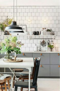 Flat gray cabinets and white subway tile