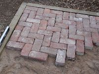 Finishing steps with mortared brick pinterest patio wall how to build your own brick patio and a few mistakes to avoid brick walkway diypatio solutioingenieria