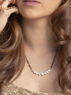 This solitaire diamond mangalsutra is a stunning piece made of fancy cut marquise, pear and round diamonds. The chain is made of 22K white gold. #bridaljewelrygoldnecklace