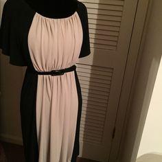 Beige and black dress Black and beige elastic waist dress the back of the dress is black. Dresses Midi