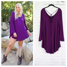 Purple dress with bell sleeves and criss-cross tie in back, hi-low hemline