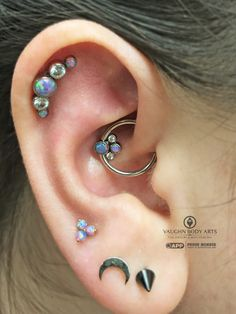 A gorgeous daith Adam did for our client Marjorie. Marjorie put together this lovely @anatometal captive cluster combination consisting of CZ's, a teal opal, and a light purple opal. A perfect choice to compliment her other piercings. Thank you as...