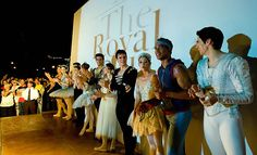 Dancers of the Royal Ballet and Cuban National Ballet are applauded in front of a screen where many Cubans watched a special presentation on July 15...