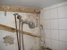 black mold growing behind the bathroom wall because a bathroom is