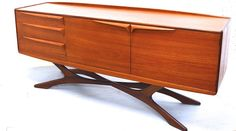 One of the most sought after, exceptionally rare sideboards by Scottish manufacturer Beithcraft. This particular piece is sometimes known as 'The Organic Range'. We have fully restored this sideboard sympathetically and it is now in absolute immaculate condition.