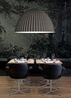 Playing with scale creates super-drama in the black dining room. Love!
