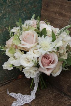 dusky pinks and creams.  LOVE the veronica poking out to give height and interest to bouquet.