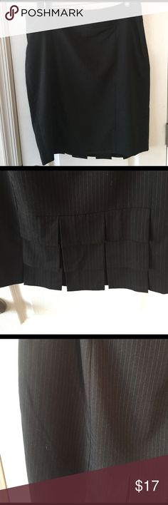 The Limited Pin stripped straight skirt Pin stripped black skirt from The Limited size 12 with back pleats at the hem and a hidden side zipper. Fully lined. Like new condition. The Limited Skirts Pencil