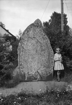 """historical-nonfiction: """" A girl with a teddy bear at a runestone in Söderby, Sweden, in The inscription reads, """"Sibbe and Tjarve had the stone raised in memory of Torkel, their father. Ancient Runes, Ancient Mysteries, History Mysteries, Viking Art, Viking Runes, Viking Woman, Rare Historical Photos, Rune Stones, Old Norse"""