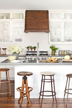 Creative Seating An assortment of old stools provides quirky charm in the kitchen of this Oregon home.