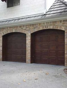 Woodgrained Garage Doors by Garay Artisans. What a change from white! #woodgrain #fauxbois
