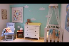Gender neutral vintage inspired baby room using an aqua + primary colors theme with cloud decals and circus and pinwheel motifs. By Ellie :)