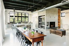 Open plan living area with a distinct industrial style - Decoist