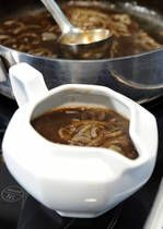 Onion Gravy -  A thick, rich, sticky onion gravy is the perfect sauce for many great traditional British and Irish meat dishes. This recipe for onion gravy is so quick and simple to make and is perfect with Bangers (sausages) and Mash, most roast meats, slathered on a Toad in the Hole or as a filling for Yorkshire puddings.