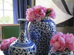 Blue vases with pink flowers