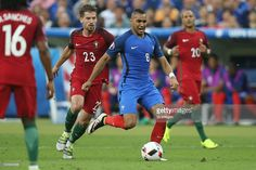 #Adrien Silva of Portugal, Dimitri Payet of France, Ricardo #Quaresma of #Portugal during the UEFA EURO 2016 final match between Portugal and France on July 10, 2016 at the Stade de France in Paris, France.