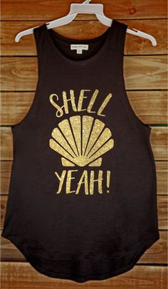 "Shell Yeah Tank Are you really a mermaid? Shell yeah! Cut: Long Muscle Tank Color: Black Material: Extra soft cotton blend Style: ""Shell Yeah"" Glitter Gold *For best results, hand wash cold and air dr"